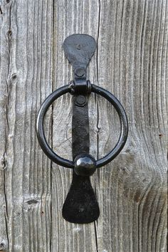 A lovely simple ancient folk art design door knocker.Handforged from solid worught iron by a blacksmithon an open forgein the traditional way.. The knocker comes complete with slotted head screws...It measures 24.7cms tall and 11.4cms wide..9 3/4 inches tall and 4 1/2 inches wide.
