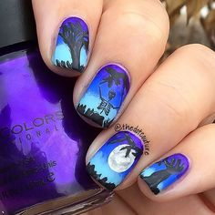 Halloween Nail Art! 🎃🎃🎃🎃🎃 I created a gradient using @sinfulcolors_official Let's Talk, and @sallyhansenca Pacific Blue and Blue Away. I hand painted the moon and trees with black and off-white acrylic paint. The skeleton was stamped with @bundlemonster plate BM-413.