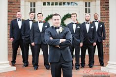 Taking a picture of a #groom with his #groomsmen in front of the church. To see more pictures go to www.carolinezphotography.com