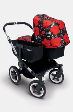Andy Warhol-designed flower print. Includes sun canopy and carrycot apron. Black…