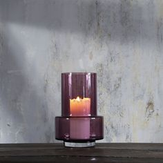 Night-time moods are created with light. With inspiration from the antique kerosene lamps, where a tall cylinder of glass spreads the light and protects the flame from the surroundings, the Hurricane is born. Hurricane adds evocative light to summer nights on balconies and terraces and lights up cosy moments indoor.   The spacious inner of the Hurricane allows the candle to burn with a steady flame, regardless if it has been placed indoor or outside.