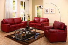 Creative Style Living Room Inspiration with Cream Wall Paint COlor and Modern Red Leather Sofa Set and Minimlaist Coffee Table and Wooden Floor and Unique Floor Lamp