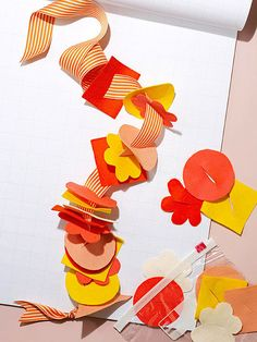 """Keep toddlers occupied anywhere with this """"sew"""" fun #craft. Make slits in felt shapes and cut a length of ribbon that your child can thread the pieces onto."""