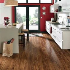 Pergo XP Golden Tigerwood 10 mm Thick x 5-1/4 in. Wide x 47-1/4 in. Length Laminate Flooring (13.74 sq. ft. / case)-LF000742 at The Home Depot