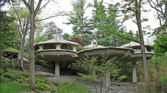 This house is a 'feast' for the eyes. I seriously had to pause the tour so that I could take extended looks at the rooms. It is called the Mushroom house. It is in Pittsford, NY.  Because of it's unusual design it has been made a landmark for the area.