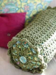 This crocheted bolster cushion has been designed by Erika Knight and uses Amy Butler's Sweet Harmony.