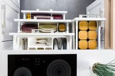 Top view of organized kitchen drawers and electric kitchen stove. Modern kitchen organization of spaces.