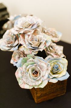 paper flowers http://www.weddingchicks.com/2014/01/13/diy-dapper-deco-wedding/