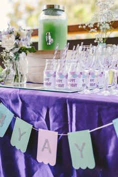 Glass milk bottles with mermaid scale labels from a Whimsical Mermaid Birthday Party on Kara's Party Ideas | KarasPartyIdeas.com (12)