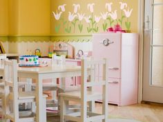 The Cutest Decals for Kids  Wall decals aren't just for bedrooms or bathrooms. Go wild and plant some in a playroom. These pink blooms work with the existing wall trim and let everyone know that this mini-kitchen is where girly fun gets cooked up. Photo courtesy of SissyLittle