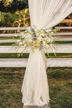Flowy drapery and white flowers ~ Mora Photography   bellethemagazine.com