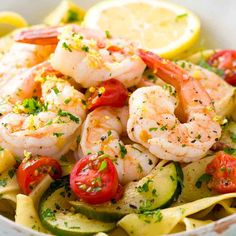 Shrimp pasta recipe with lemon garlic sauce served with zucchini and tomatoes. A simple, healthy meal prepared in only 30 minutes. #video #shrimppasta #shrimp #quickrecipe
