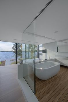 Minimalist Bathroom // Modern bath with a view. Glass, white and chrome finishes. House by a Lake by BBSC Architects» CONTEMPORIST