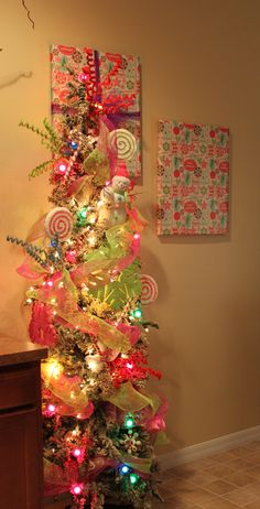 Our bright/candy kitchen tree. Maybe, a pencil tree with spray snow and decorations. Christmas Tree Roses, Pencil Christmas Tree, Slim Christmas Tree, Christmas Gingerbread, Pink Christmas, Christmas Holidays, Christmas Crafts, Xmas Trees, Christmas Signs