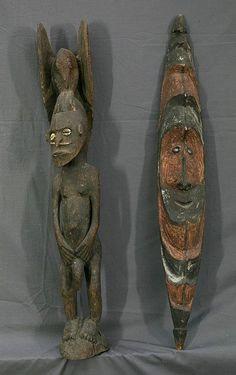 2 PNG Artefacts.  Flute mask, Ramu Valley, Madang; standing male spirit figure, surmounted by bird, & with shell eyes.  Wood, Ochre
