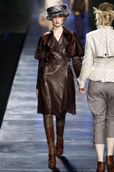 Christian Dior Fall 2010 Here is a long belted coat made with a removable shoulder cape. inspired ulster coat
