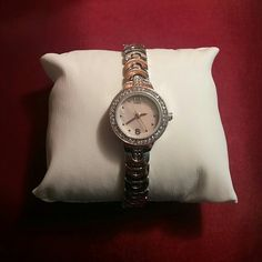 BUNDLE Silver tone watch and bracelet NWOT Pretty in pink watch with pale pink face, simply precious, little bling around face, and bracelet selling together. Jewelry