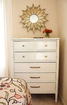 White tallboy with gold hardware + gold sunburst mirror