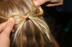 cute.      take section of hair from both sides of head, bring back to middle back and tie into bow,