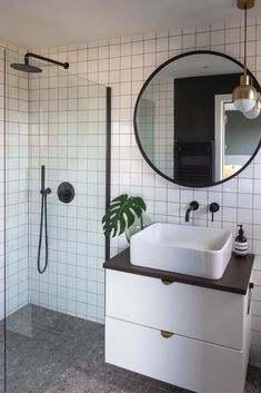 Bathroom GOALS with our Umbra HUB MIRROR! Its circular shape and rubber trim adds dimension, texture and durability, making it great for any entryway, bathroom or living space. Photo by Loft Bathroom, Upstairs Bathrooms, Bathroom Goals, Black Tile Bathrooms, White Bathroom Wall Tiles, White Square Tiles, Small Shower Room, Walk In Shower, Bathroom Interior Design