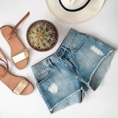"""Denim shorts by Eleven Paris size 26 Denim cutoff shorts by Eleven Paris. Brand new with tags. Size 26. Approx 27"""" around waist, 8"""" rise and 1.5"""" inseam. Sandals available in separate listing. No trades, no pp, no exceptions!!! Eleven Paris Shorts Jean Shorts"""