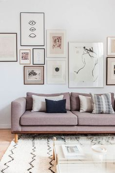 In love the calming serene colors, colored couch and gallery wall