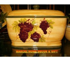 Kitchen Decor Grape Desing Tuscany Wine Bread Canister Box by Marcel Imports. $49.34. TUSCANY DECOR CERAMIC BREAD BOX, FRUIT OR COOKIE JAR Your morning little brighter with this beautiful Tuscany bread box.This ceramic bread box features the very popular Tuscany theme hand painted dish washer safe you can use this as a bread box or to keep your favorites cookies or even fruit.DEMENSIONS: Approximately It measures 12 1/2 inches in length and stands 8 inches high....