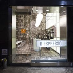 D'espresso by Nemaworkshop...nice bookcase wallpaper everywhere....even on the floor!