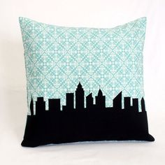 RESERVED - Custom 14x14 NYC Pillow - Tiffany blue and black. $40.00, via Etsy.