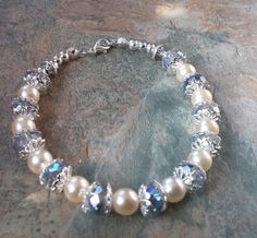 A stunning Pearl with iridescent crystal handmade with silver details bracelet, wedding, bridesmaids, by SpryHandcrafted on Etsy Selling On Pinterest, Handmade Beads, Rose Quartz, Iridescent, Pearl Necklace, Bronze, Time Shop, Pearls, Crystals
