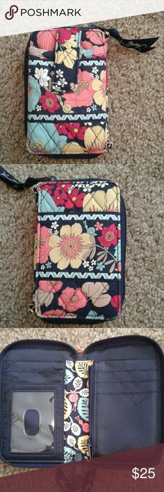 Vera bradley little wallet Cute wallet, vers Bradley wristlet, so cute, my hand shows size, navy, yellow a Little red and other colors Vera Bradley Bags Clutches & Wristlets