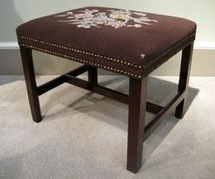 A fine Chippendale design 18th century mahogany stool with square chamfered legs united by H stretchers. Circa 1770. Old needlework upholstery.