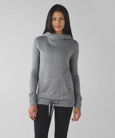 Lululemon Sweet Savasana Pullover in heathered medium gray. This super-soft knit hoodie wraps at your neck and hugs at the hem for a cozy, post-yoga embrace. Boolux™ fabric blends rayon from bamboo with TENCEL® and cashmere for added warmth drawcord at the hip lets you customize your fit reach inside the kangaroo pocket to warm your hands or stash your phone in the hidden media sleeve thumbholes help keep sleeves down and chills out