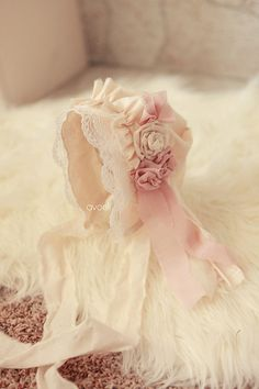 Ruffled newborn bonnet with dusty rose and creme accents and lace photography prop. $39.00, via Etsy.