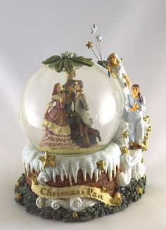 $ 49.00Music choice: Silver Bells Charles Dickens Heritage water globe scene of Christmas Past... 6 x 5 inches.. 1 only... Plays 'Silver Bells'...