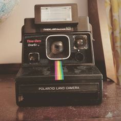 I found this super awesome old school polaroid camera at work. I wanted it so bad but it was for decoration. Just look at that color pop rainbow right down the middle! photography rainbow Welcome 80s Aesthetic, Aesthetic Vintage, Aesthetic Photo, Aesthetic Pictures, Brown Aesthetic, Retro Photography, School Photography, Nostalgia Photography, Photography Wallpapers