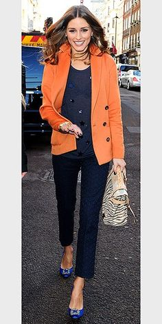 Model and New York socialite, Olivia Palermo, contrasts her blue knitwear with this season's hottest colour: orange