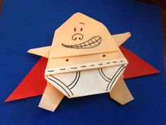 I may get to meet Dav Pilkey this weekend... So I made this origami Captain Underpants to give to him. It's sort of a combination of the simple Yoda and Santa folds.