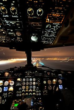 Boeing 777 cockpit at night.