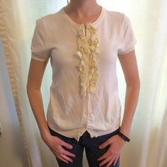 J. Crew Short Sleeve Ruffle Button-up Sweater Top You can wear this by itself or over a tank for work or weekend // beautiful and feminine // 100% cotton J. Crew Tops