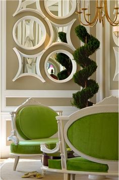 Love the chairs and mirrors.