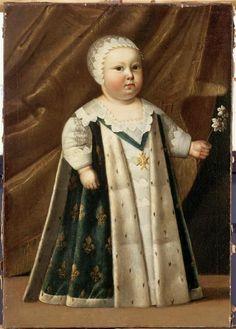 Portrait de Louis XIV (1638-1715) enfant, en pied, revêtu du manteau royal, représenté Dauphin vers 1640 (École française).