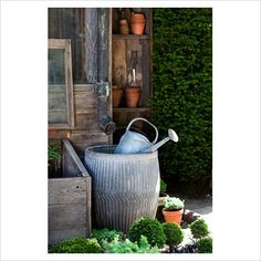 I really like this idea of catching the rainwater for watering the yard later