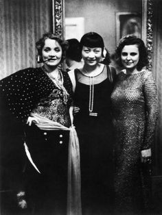 """Actresses Marlene Dietrich and Anna May Wong with Filmmaker Leni Riefenstahl at Pierre Ball"" Premium Photographic Print - Canvas Art 