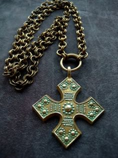Charlott's Antique Vintage Jewelry - Pendent & Crosses Bronze (Powered by CubeCart) Product Information Bronze cross from kalevala Koru,Finland.Made in the 30-40´s. The original is from the time off the Vikings.