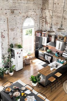 Modern industrial kitchen. Rustic kitchen ideas. Modern loft kitchen. Brick wall kitchen. High ceiling kitchen.