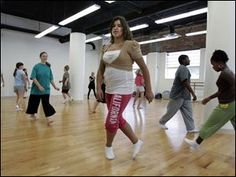 Christina Pietrzak, 12, of Toledo joins other students for dance class at the Toledo School for the Arts. Renovation of 22,000 square feet at the downtown building took nine weeks to complete and enabled the charter school to increase enrollment.  (Toledo Blade, September 2008)