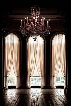 Love the tall arches and sheer curtains! Awesome for the wall going out to my back deck maybe with an all glass door in the center window