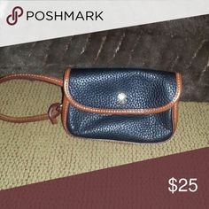 Dooney & Bourke Black leather with brown trim wristlet. Red interior.  Bought from a fellow posher. Came with what I really wanted. I don't really need this for myself.  In great condition and very clean.  Looks brand new. Dooney & Bourke Bags Clutches & Wristlets