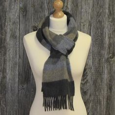 Color: Dark grey with subtle pale blue, grey and sand. long stylish scarf